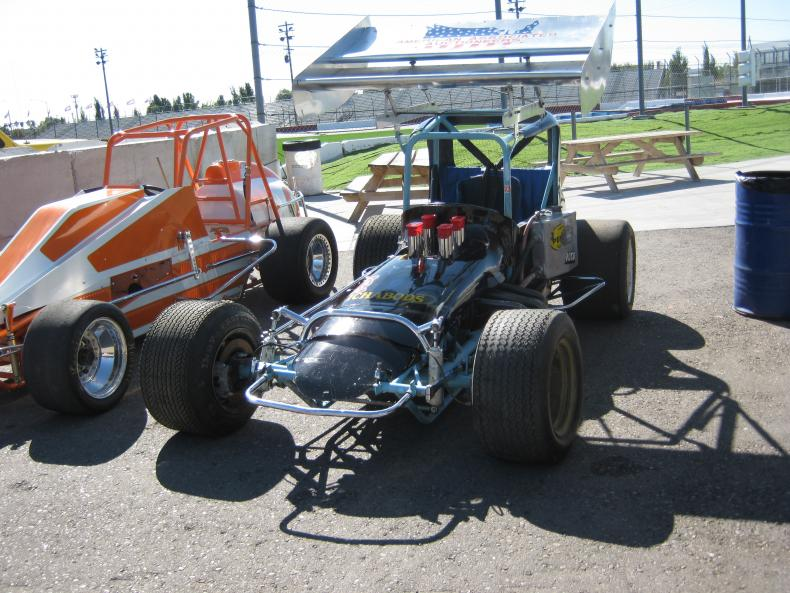 ORANGE AND WHITE CAR ON LEFT IS A SILVER CROWN SPRINT.JPG